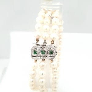 cultive parel armband 3 rij 18 karaat slot smaragd vintage tweede hands occasion juwelier den haag